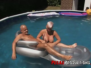 Canadian slut Bella Venusia takes part in crazy orgy by the poolside