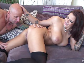 Busty bombshell Lilith Lavey rides cock with her legs apart