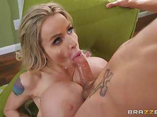 Plastic MILF with huge tits gets cum all over her slutty face