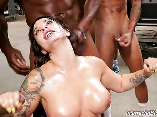 Ivy Lebelle blows every inch of her friends hard penises on the floor