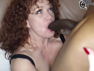 Some Hotness Curly Bitch Blowing A Really Huge Cock