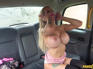 Sexy blonde jumping on a driver's fat penis in the taxi cabine