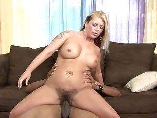 Young black stud fucks adorable blonde MILF in her hairy cunt and gives nice facial to her