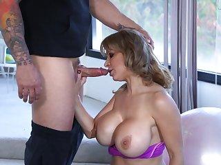 Huge fake titties on this cocksucking milf slut