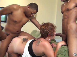 Busty and big ass BBW Scarlet in interracial gangbang with black studs